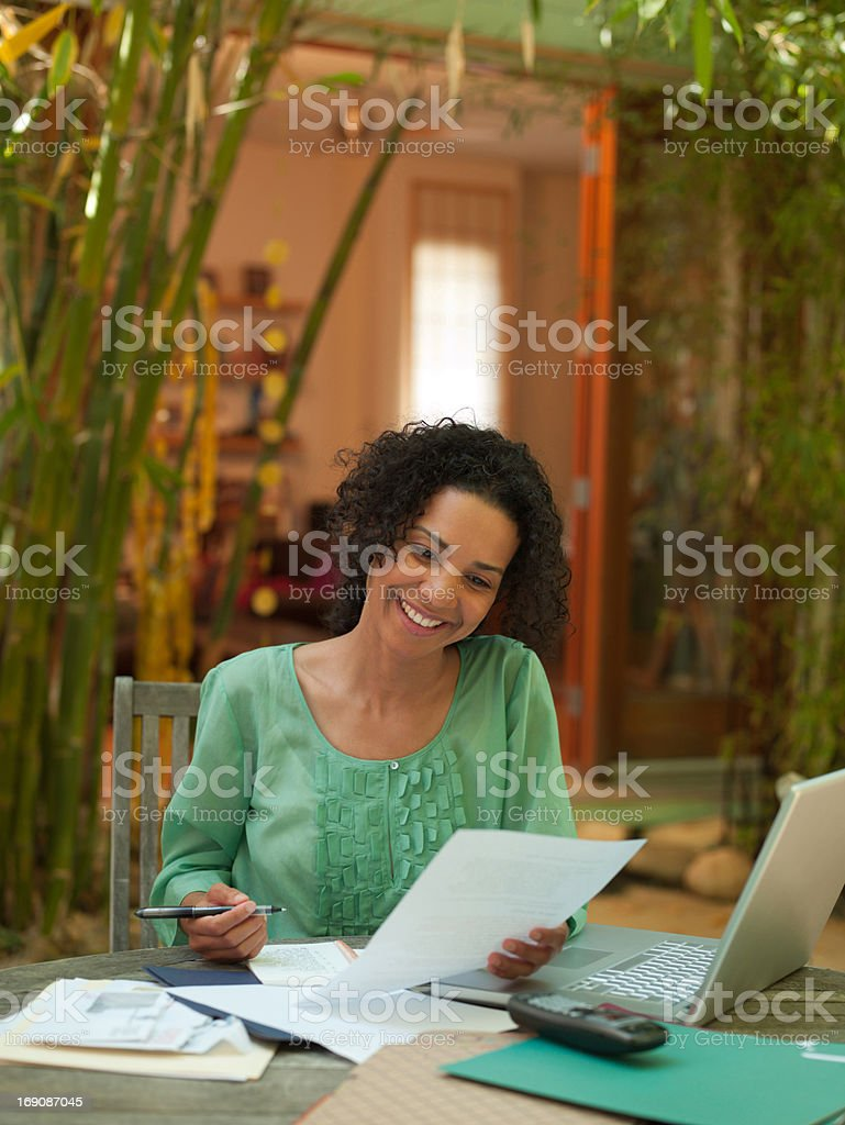 Woman working from home on patio royalty-free stock photo