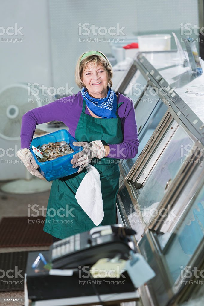 Woman working in a fish market stock photo