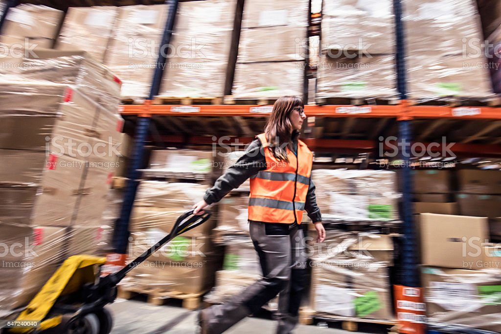 Woman working in a warehouse stock photo