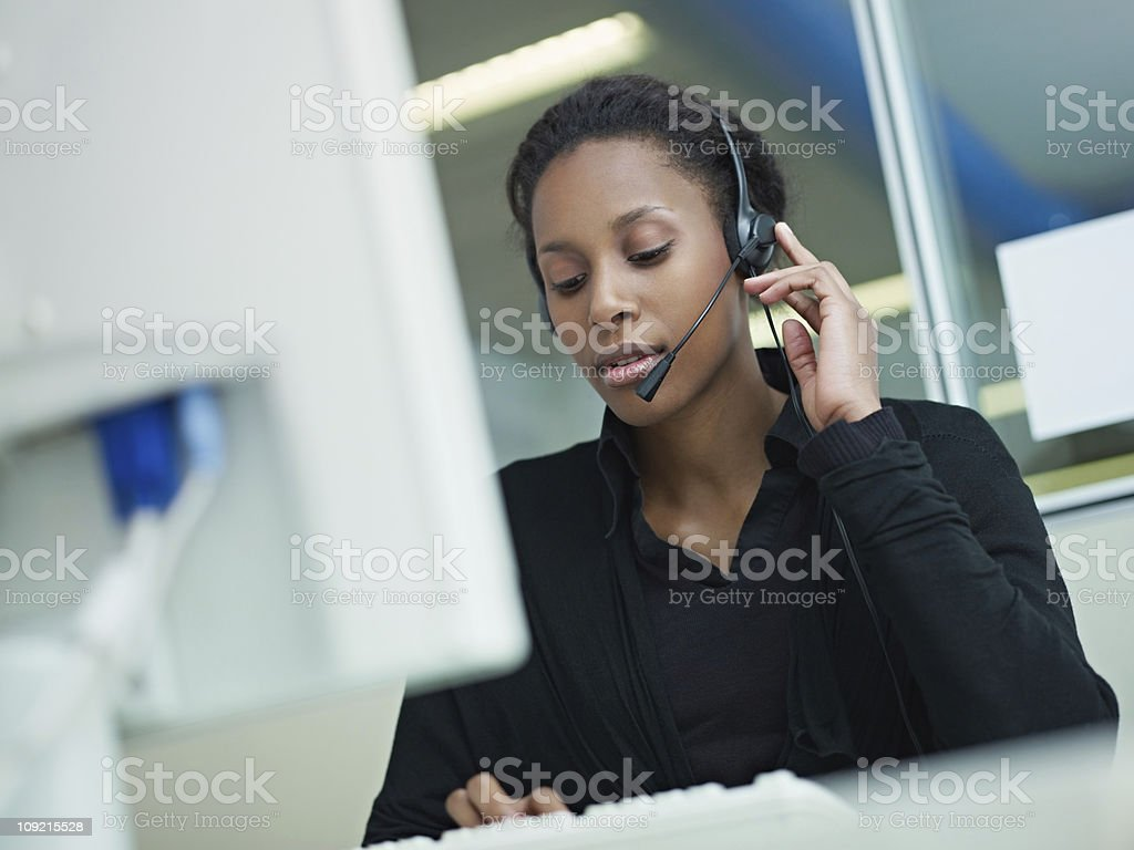 woman working in call center stock photo