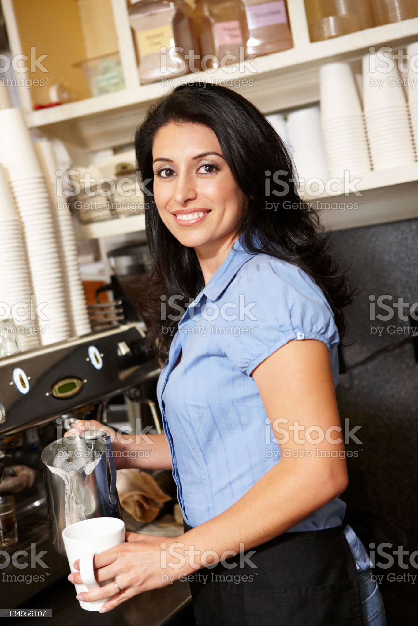 Woman working in coffee shop royalty-free stock photo