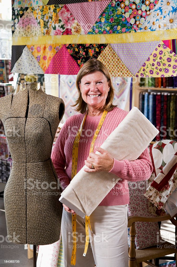 Woman working in fabric shop royalty-free stock photo