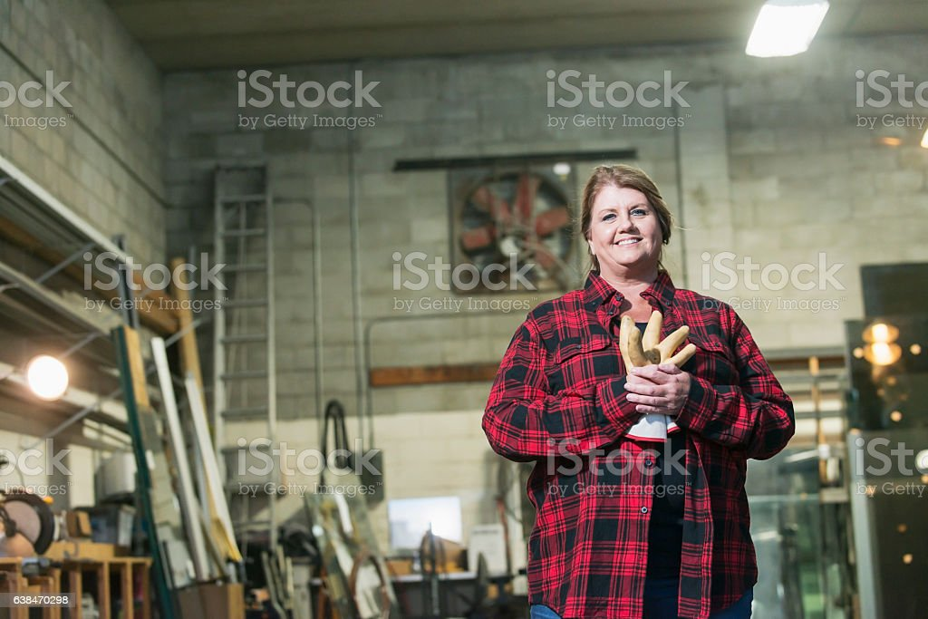 Woman working in factory warehouse stock photo