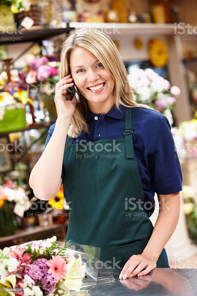 Woman working in florist royalty-free stock photo