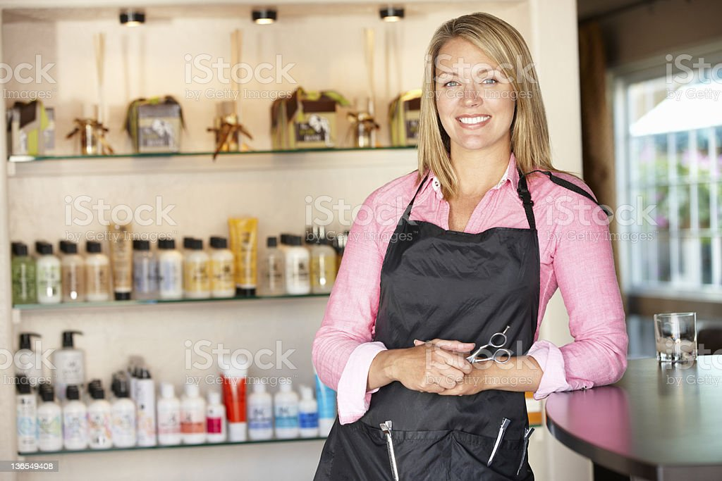 Woman working in hairdressing salon stock photo