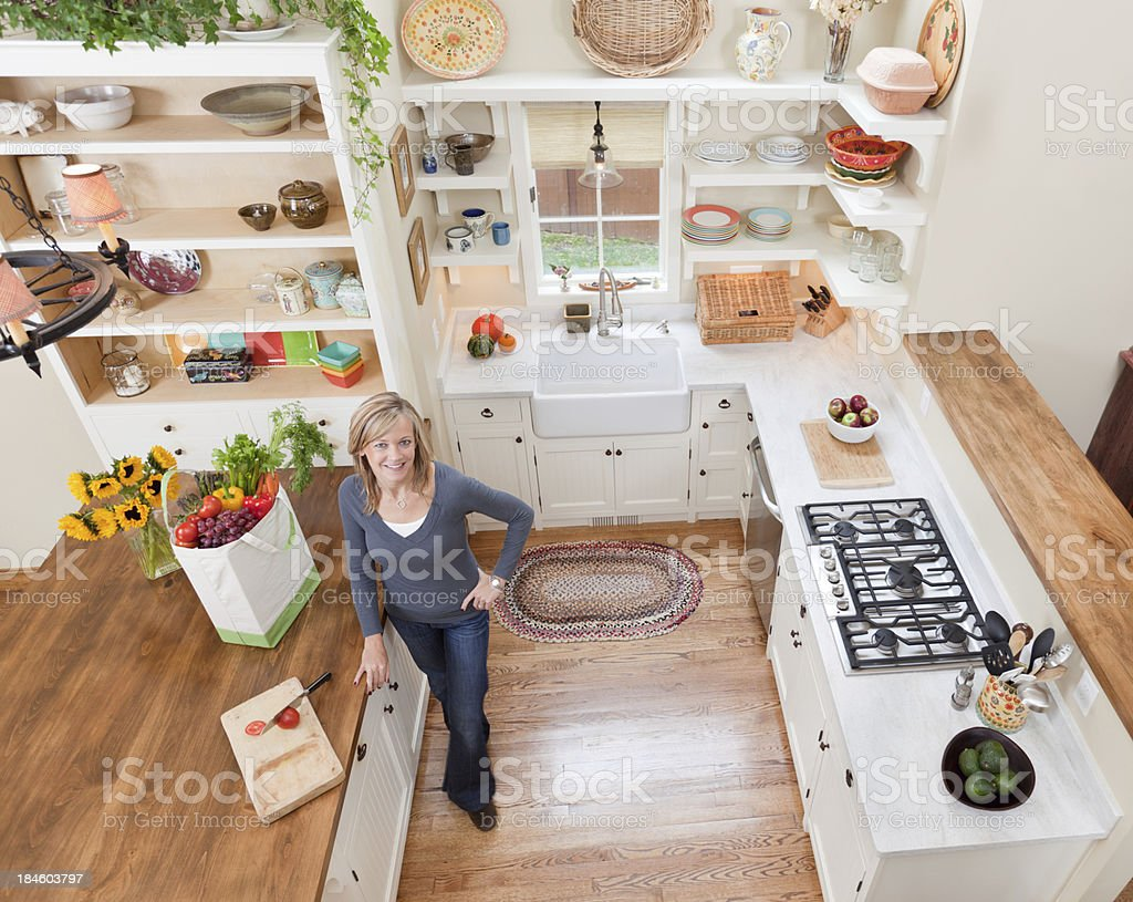 Woman Working in Her Home Kitchen with Fresh Grocery royalty-free stock photo