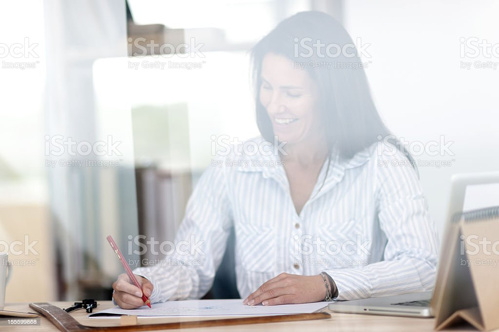 Woman working in her home office royalty-free stock photo