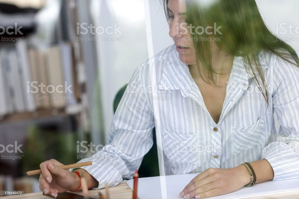 Woman working in her home office stock photo