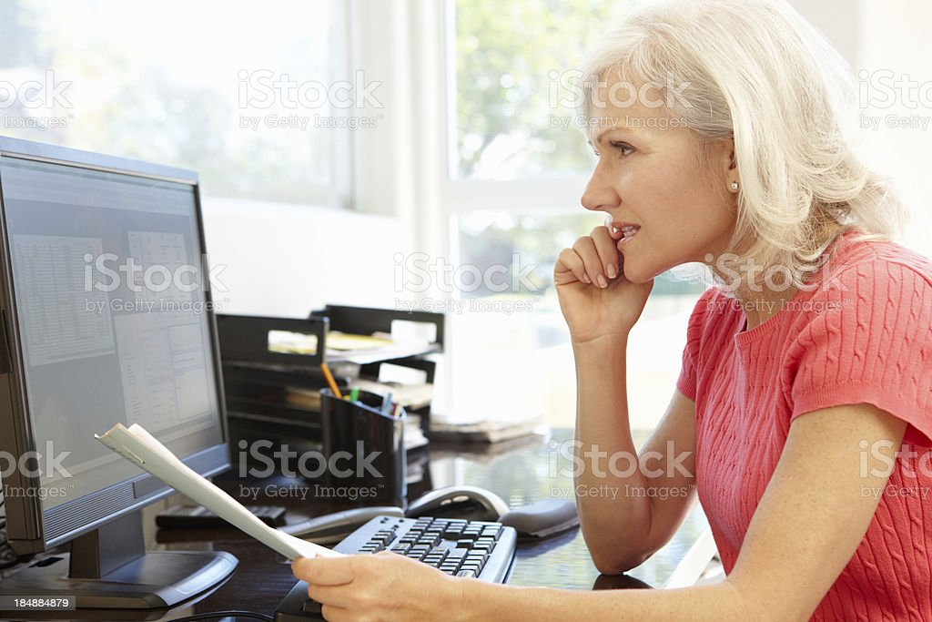 Woman working in home office royalty-free stock photo