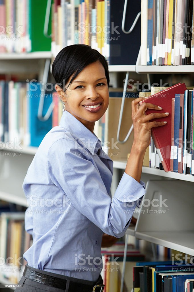 Woman working in library stock photo