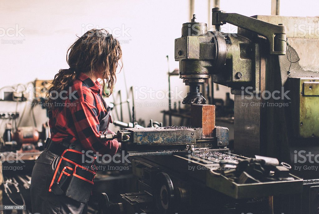 Woman working in production stock photo