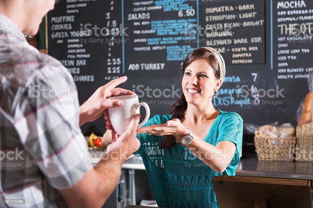 Woman working in restaurant helping customer stock photo