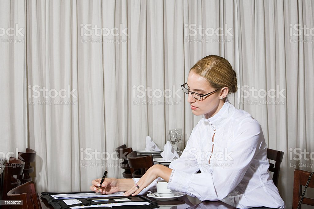 Woman working in restaurant stock photo