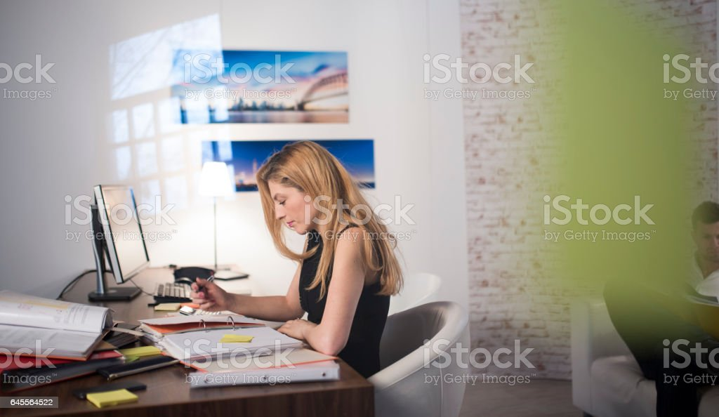 Woman working in the office stock photo