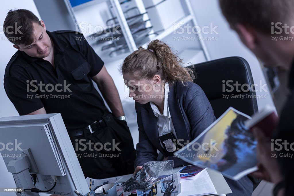 Woman working in the police stock photo