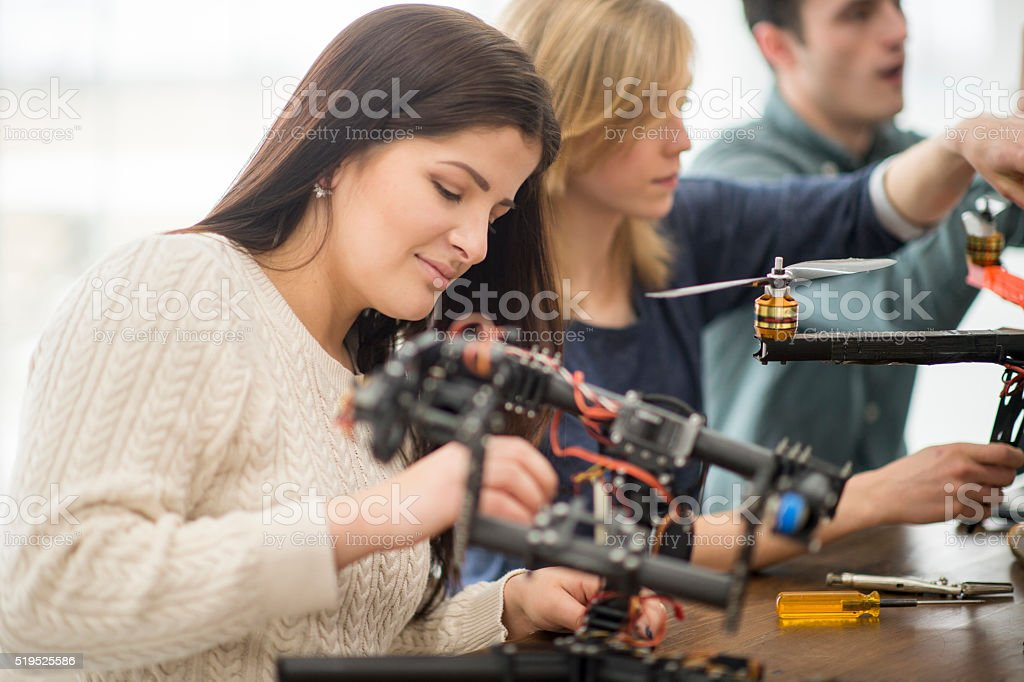 Woman Working on a Drone Project stock photo