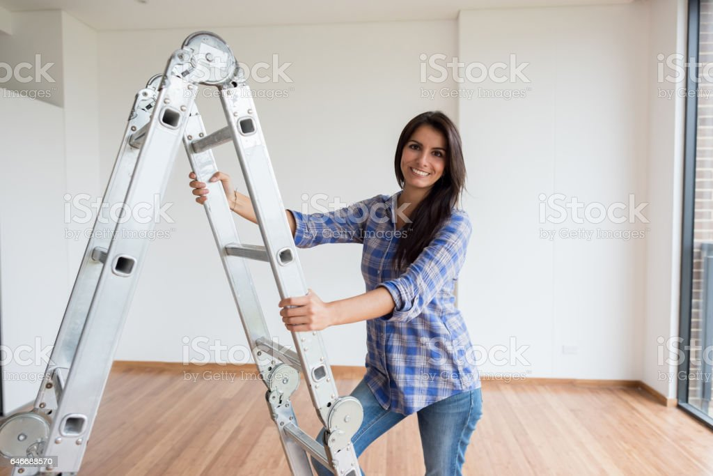 Woman working on a housing project stock photo