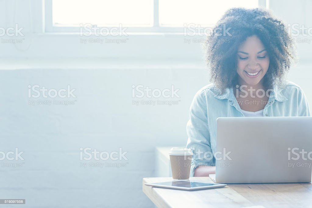 Woman working on a laptop. stock photo