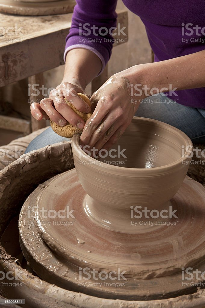 Woman Working on a Pottery Wheel. stock photo