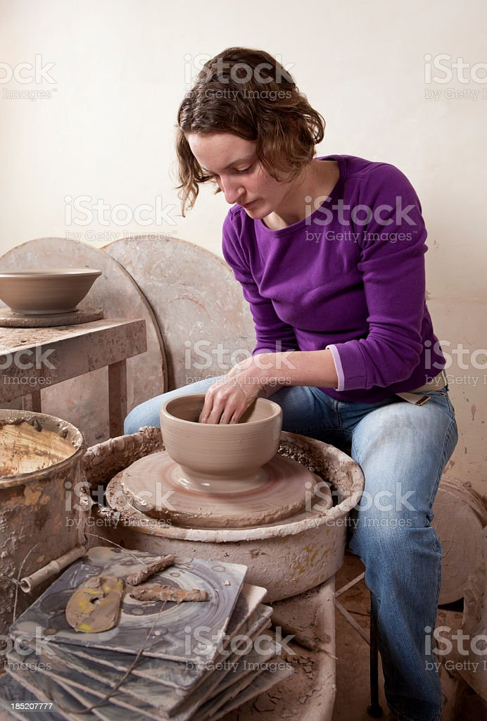 Woman Working on a Pottery Wheel. royalty-free stock photo