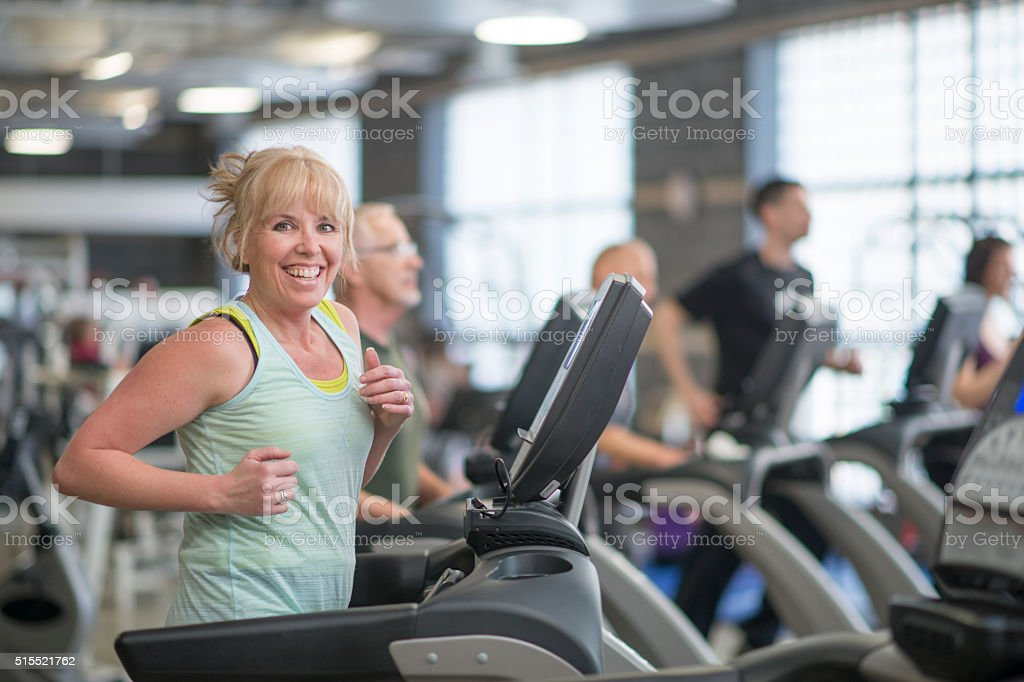Woman Working on an Elliptical Machine stock photo