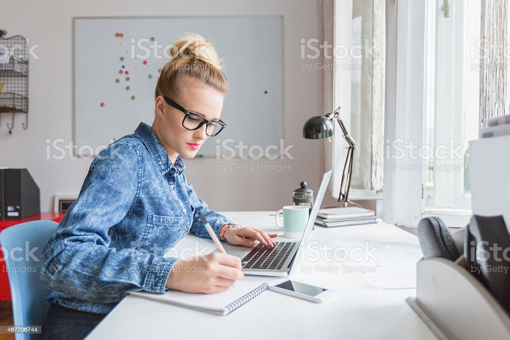 Woman working on computer in an office stock photo