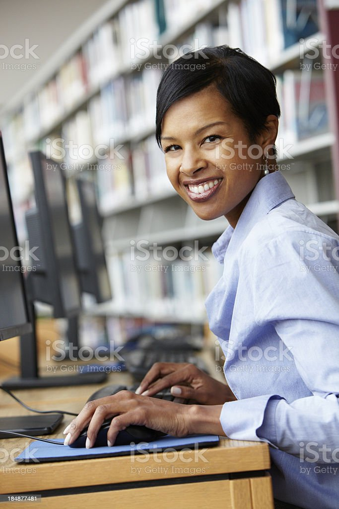 Woman working on computer in library royalty-free stock photo
