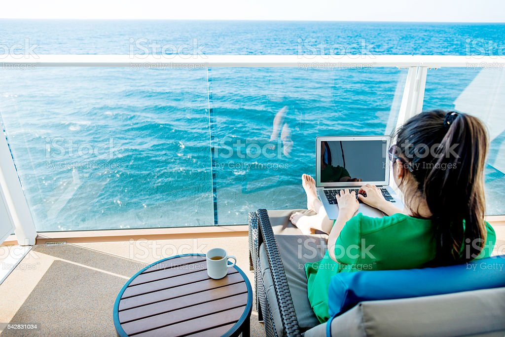 Woman working on cruise ship stock photo