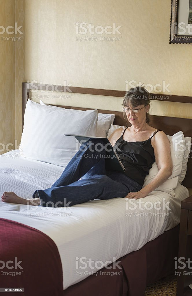 Woman working on digital tablet royalty-free stock photo