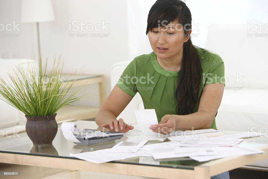 Woman working on finances stock photo