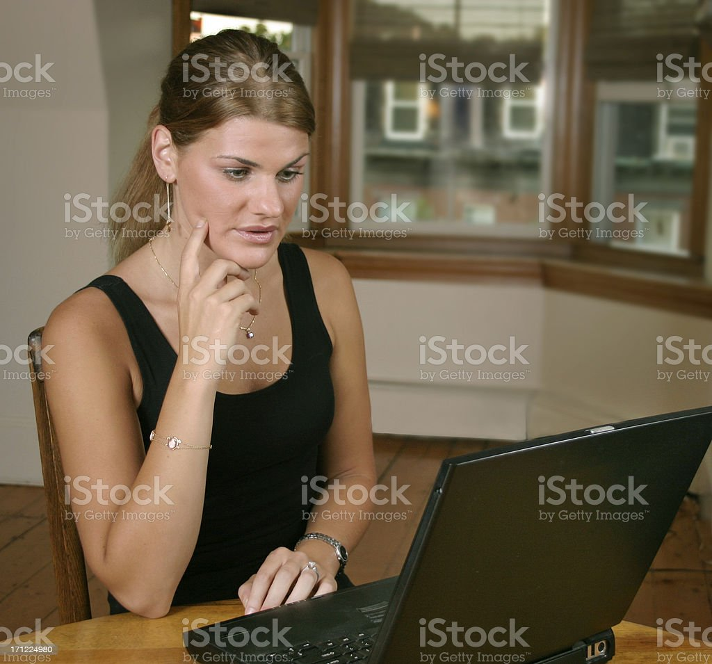Woman working on her laptop stock photo