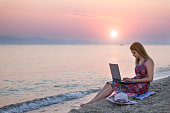 Woman working on lap top at The Morning  Sunrise
