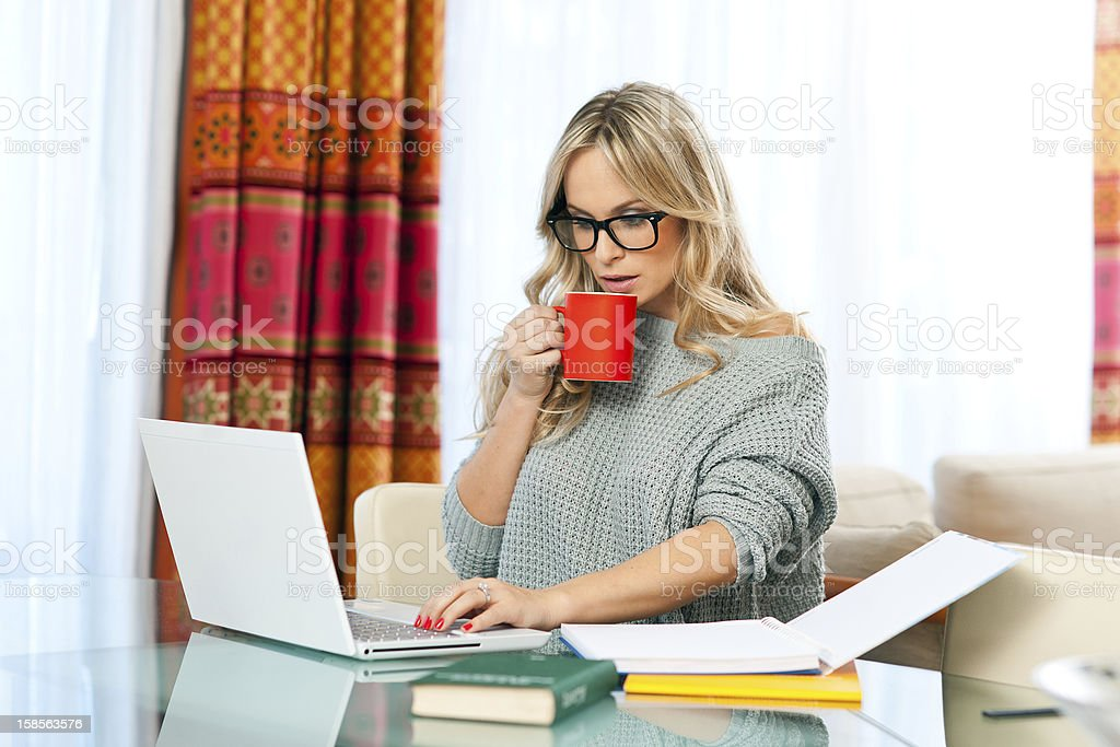 woman working on laptop at home royalty-free stock photo