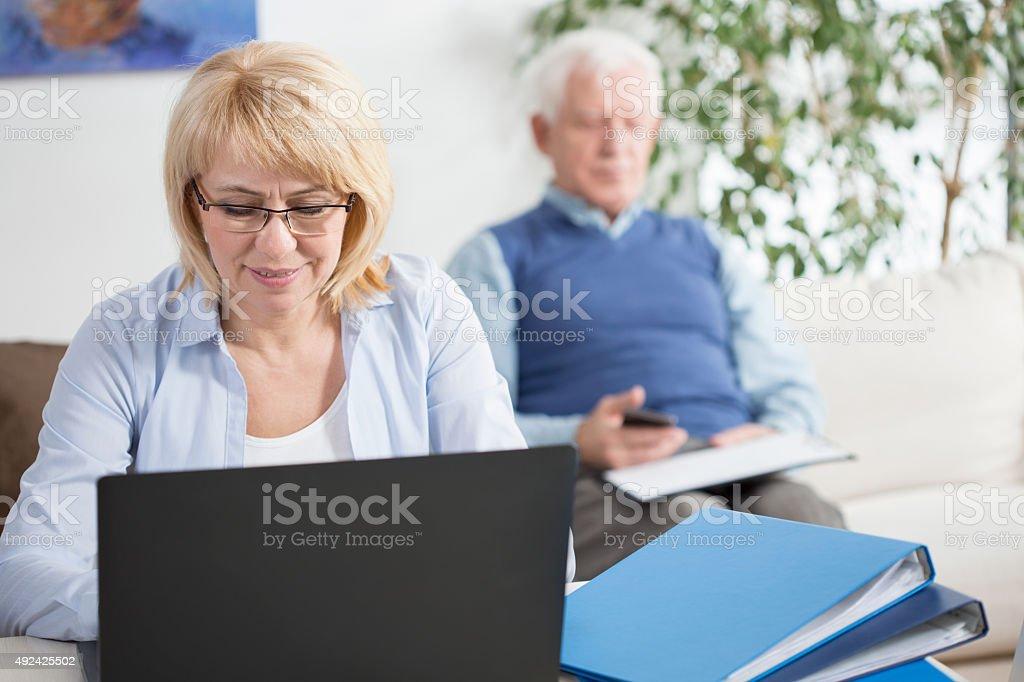 Woman working on laptop stock photo