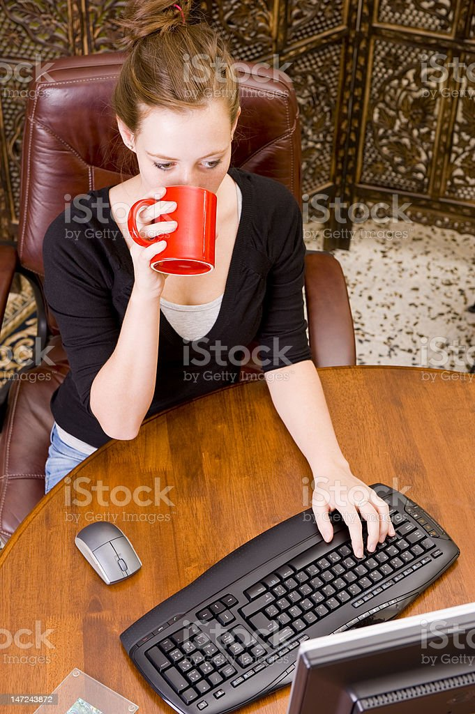 Woman working on PC keyboard and mouse. royalty-free stock photo