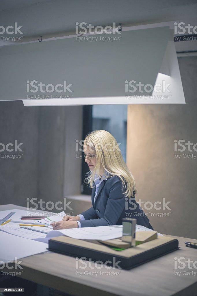 Woman working on printout stock photo