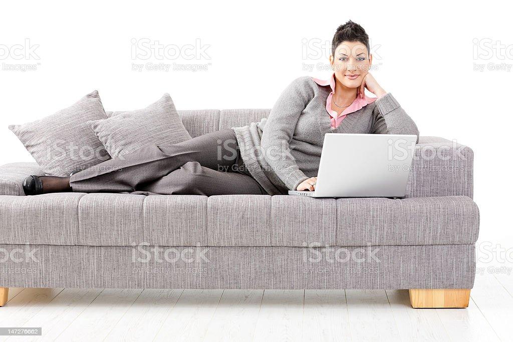 Woman working on sofa royalty-free stock photo
