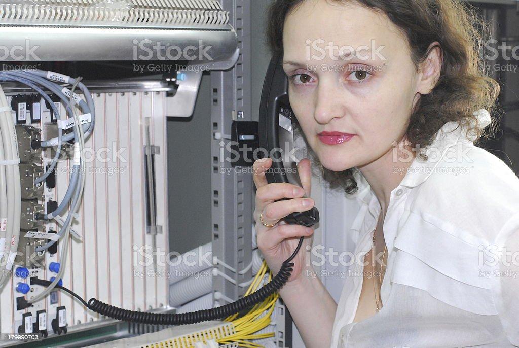 Woman working on telecommunication equipment royalty-free stock photo