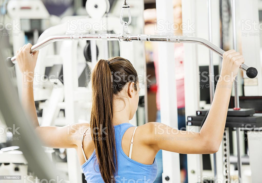 Woman working out in a gym. royalty-free stock photo