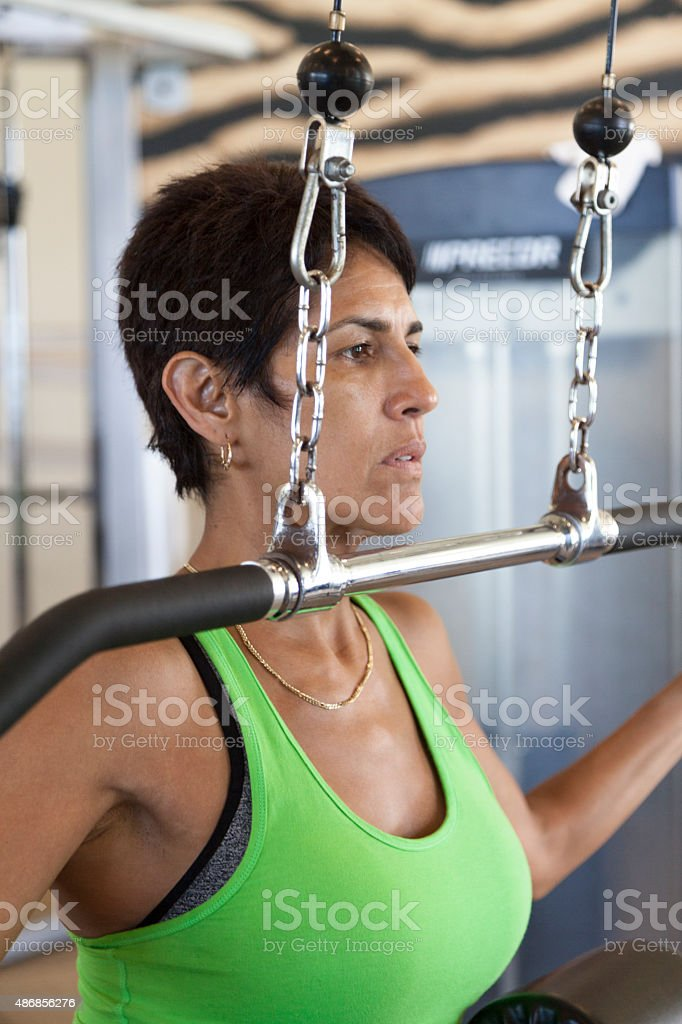 Woman Working out in gym stock photo