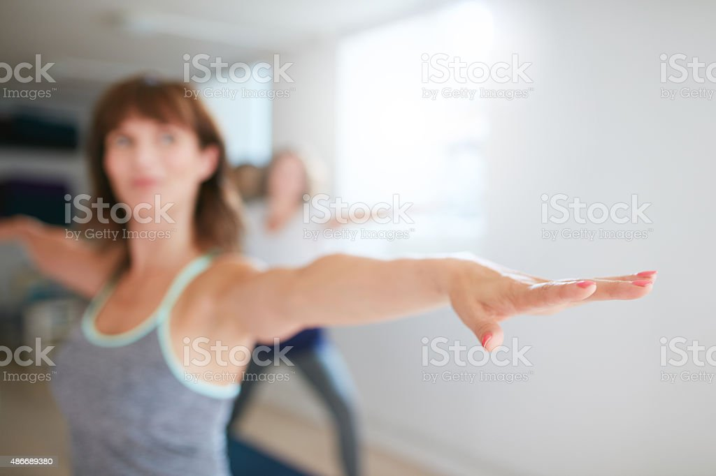 Woman working out in yoga class stock photo
