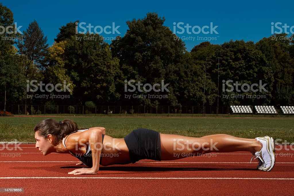 Woman working out on track and field royalty-free stock photo