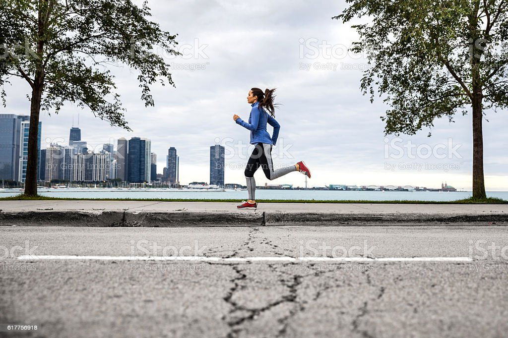 Woman working out outdoor in the city stock photo