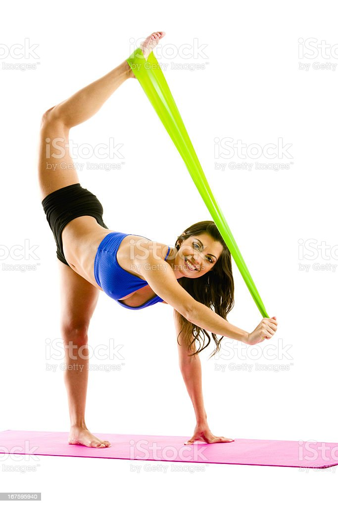 Woman working out pilates with stretch bands royalty-free stock photo