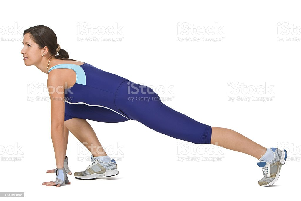 Woman working out stretching in a lunge position. royalty-free stock photo