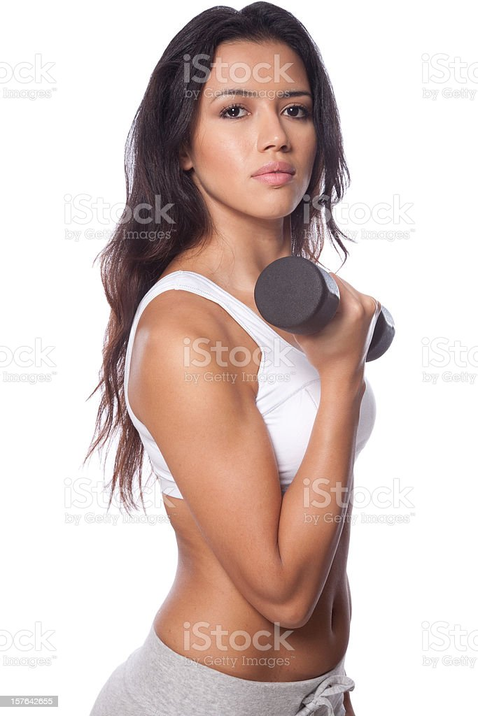 Woman working out with a dumbbell royalty-free stock photo