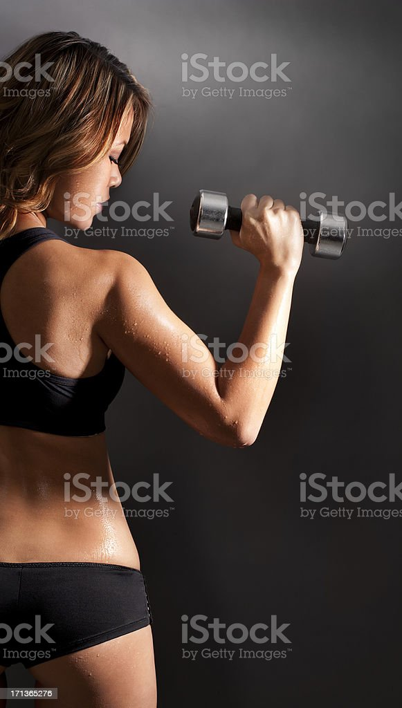 Woman working out with barbell royalty-free stock photo