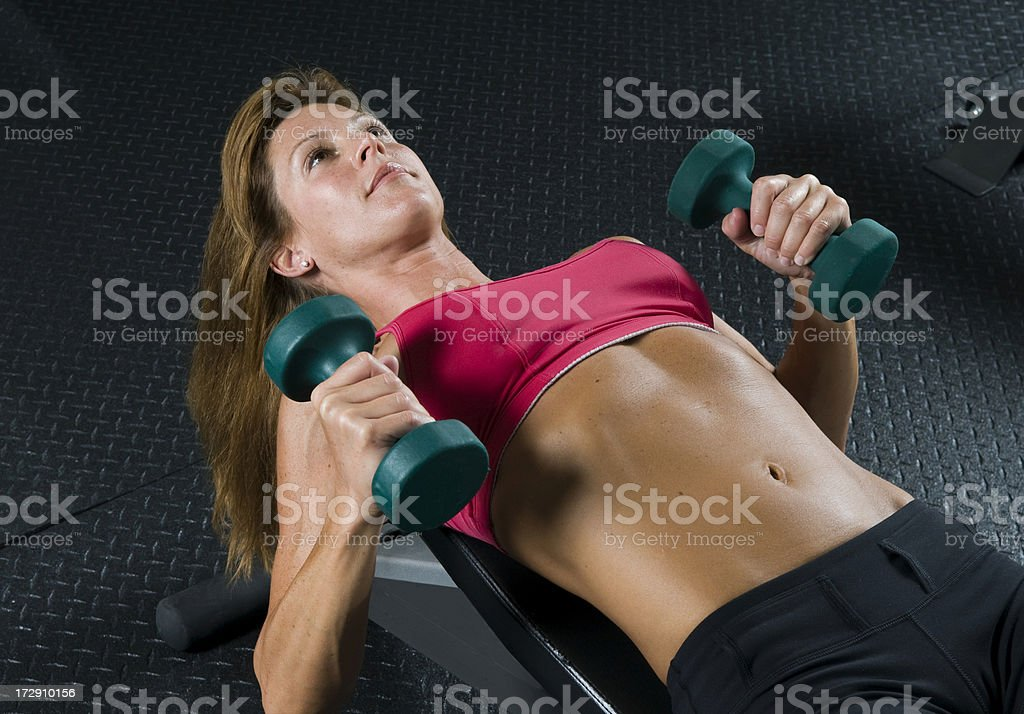Woman Working Out With Dumbbells royalty-free stock photo