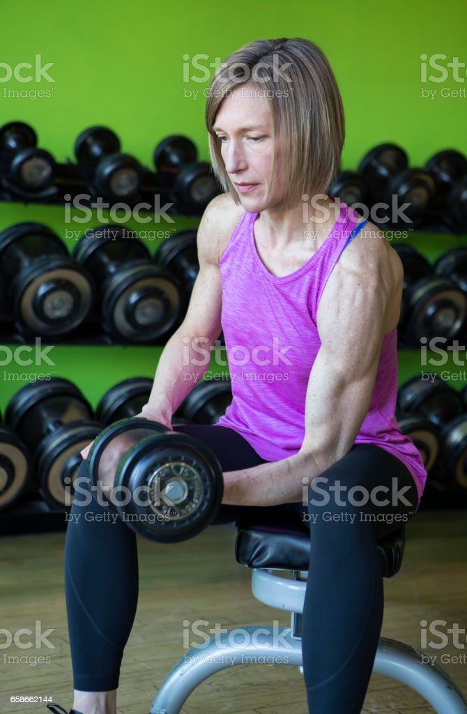 Woman Working Out With Weights. stock photo