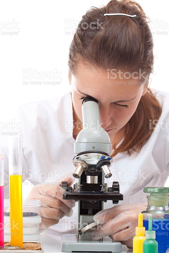 Woman working with a microscope royalty-free stock photo